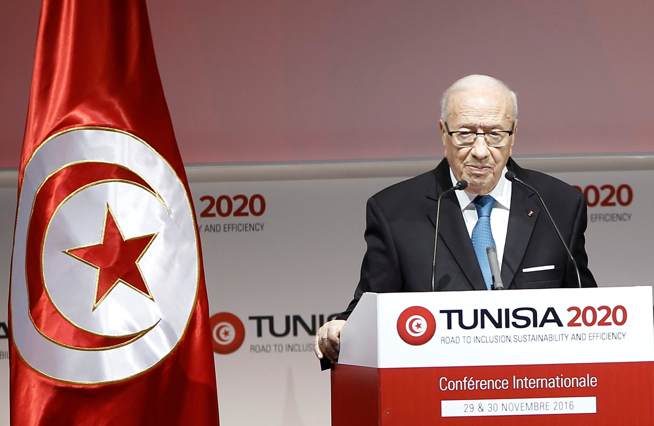 Tunisia's President Beji Caid Essebsi speaks during the opening of international investment conference Tunisia 2020, in Tunis