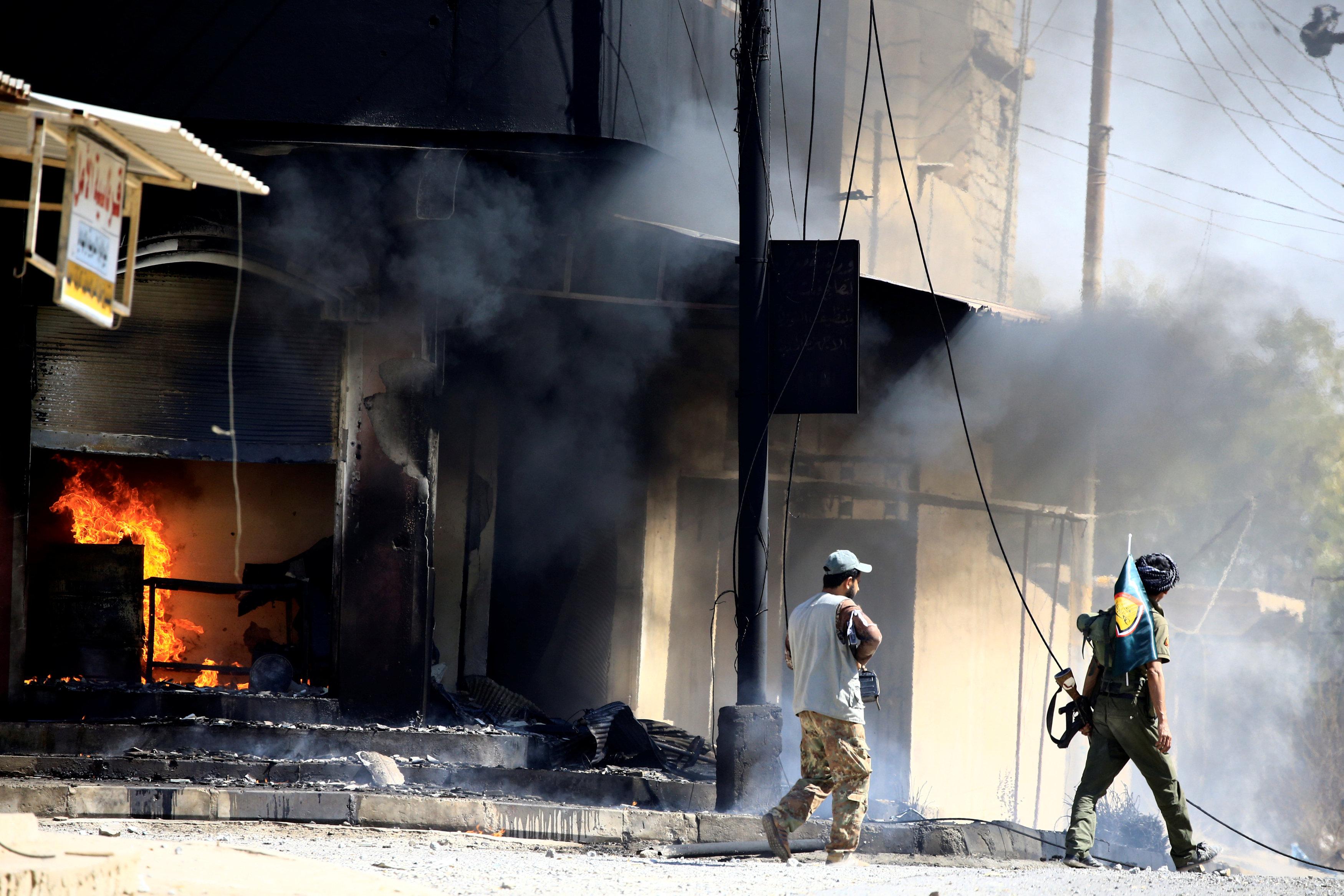 صورة التلفزيون الرسمي العراقي يعلن السيطرة على حي القلعة في تلعفر