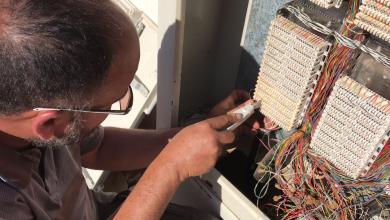 العاملون بشركة هاتف ليبيا في منطقة بدر بباطن الجبل