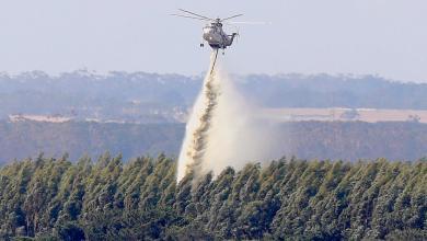 إطفاء النار بغابات في استراليا