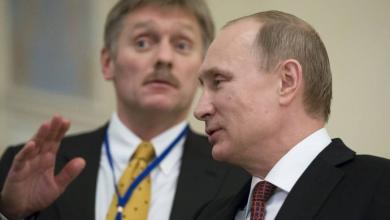 فلاديمير بوتن وديمتري بيسكوف