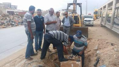 """Photo of """"جنود"""" الكهرباء ينيرون شوراع بنغازي"""