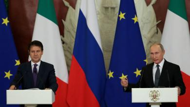 فلاديمير بوتين وجوزيبي كونتي