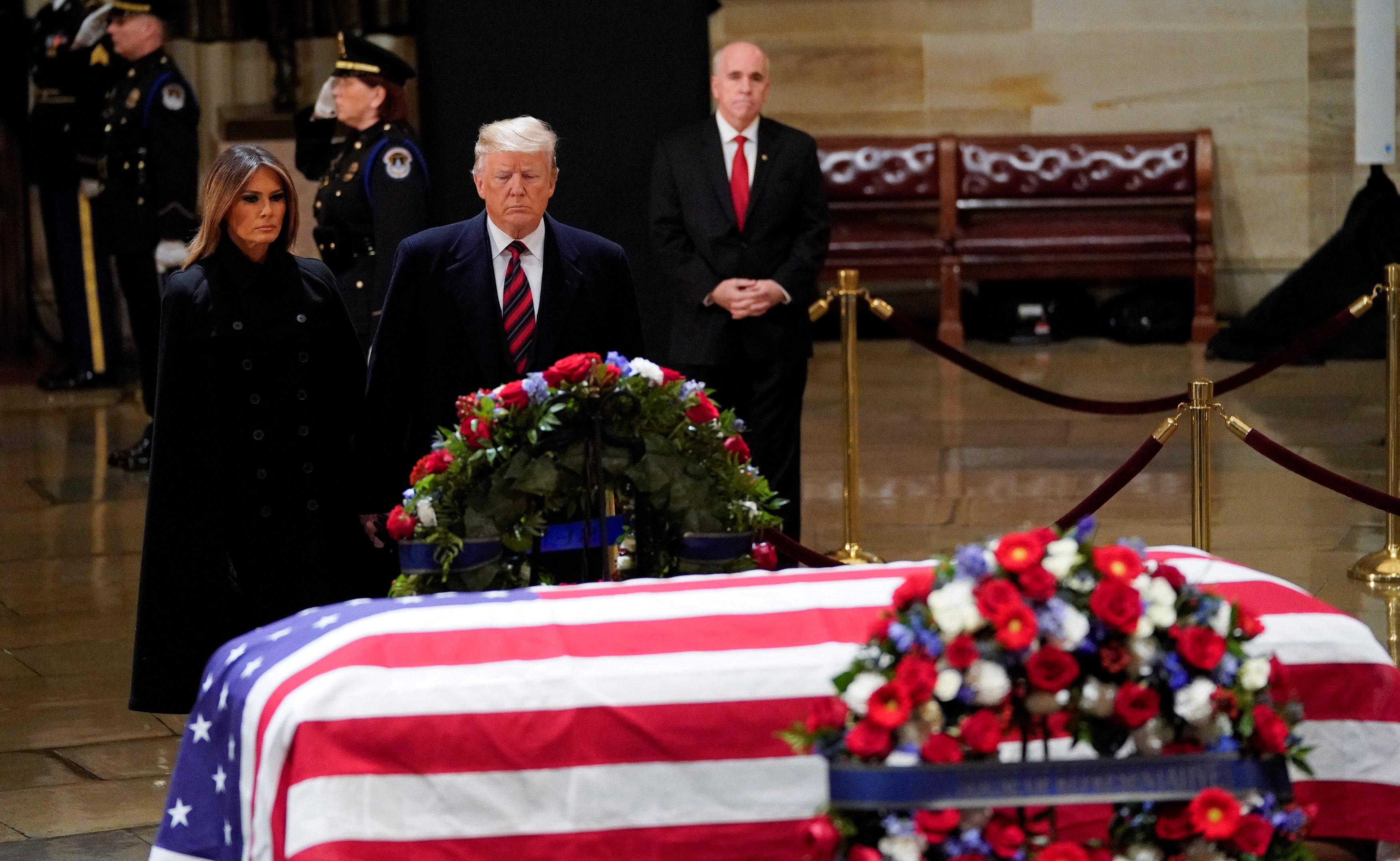 ترامب خلال جنازة جورج بوش الأب