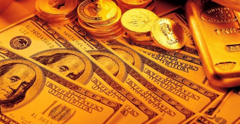 الدولار والذهب - تعبيرية
