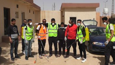Photo of متطوعون في تيجي لتعقيم المرافق الحكومية