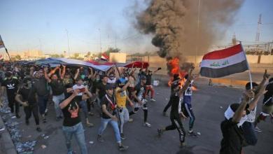 صورة بذكرى انتفاضتهم.. عراقيون يطالبون باجتثاث الفساد