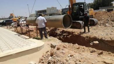 """جانب من ربط مناطق بنغازي الشرقية بمنظومة النهر شهر مايو الماضي-""""أرشيفية"""""""